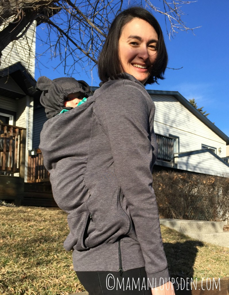 Full view of Belly Bedaine babywearing sweater and baby hood