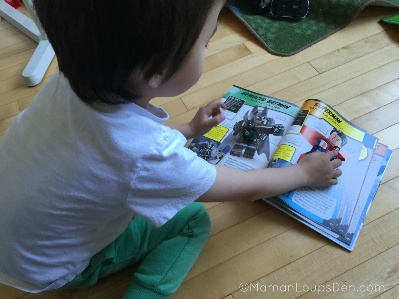 Cub Matches up his Lego Super Heroes